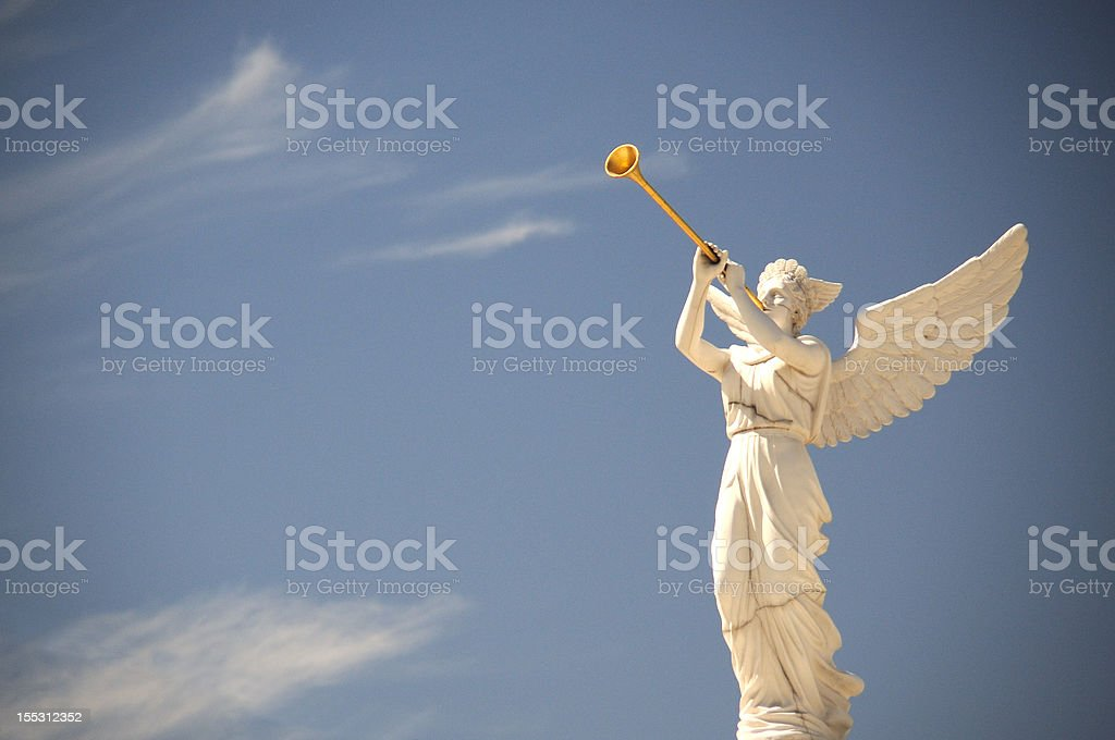 Angel blowing a horn stock photo