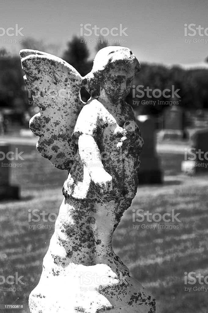 Angel body statue closeup in cemetery royalty-free stock photo