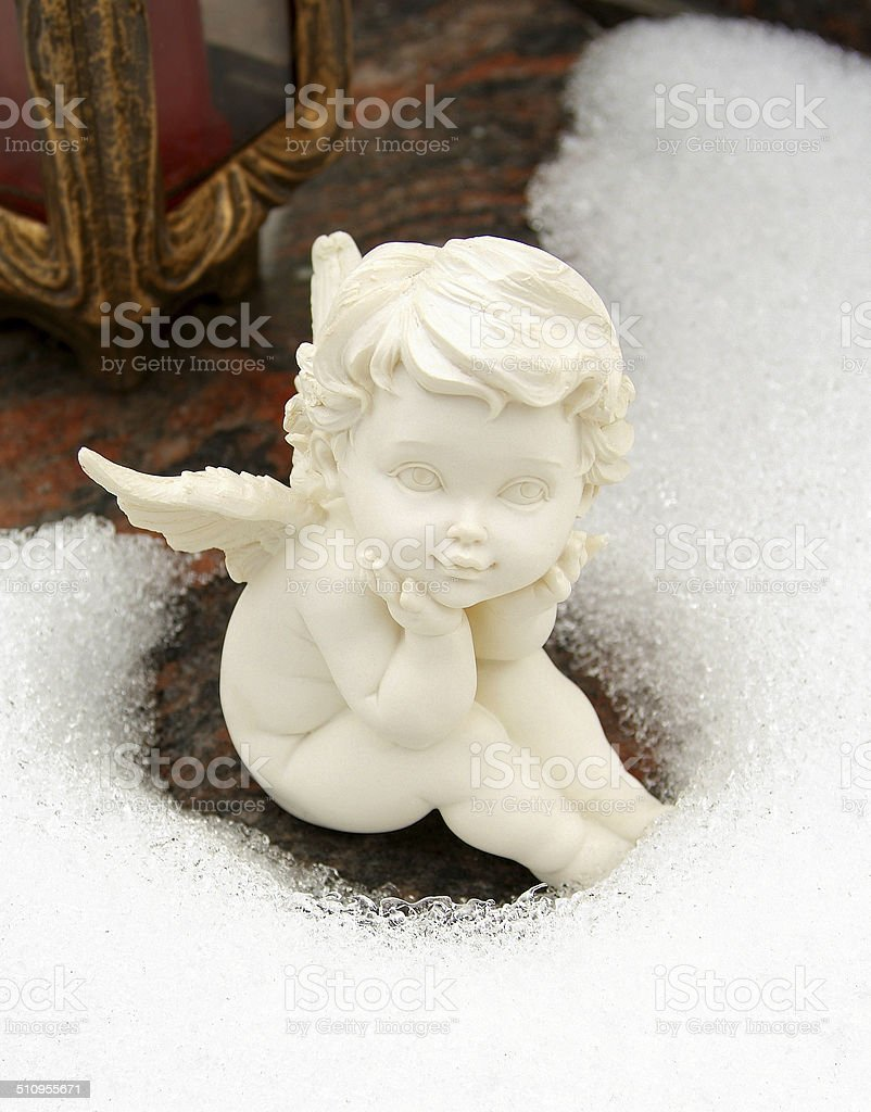 Angel can melt snow royalty-free stock photo