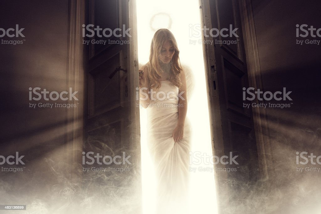 angel entering into the room stock photo