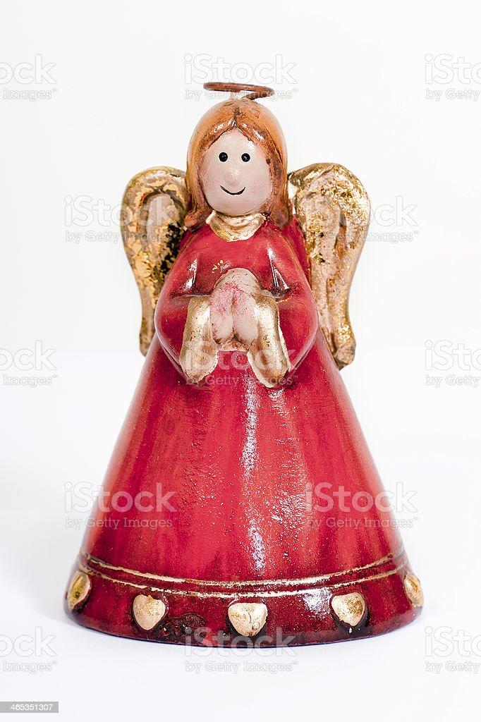 Angel figurine praying and smiling stock photo