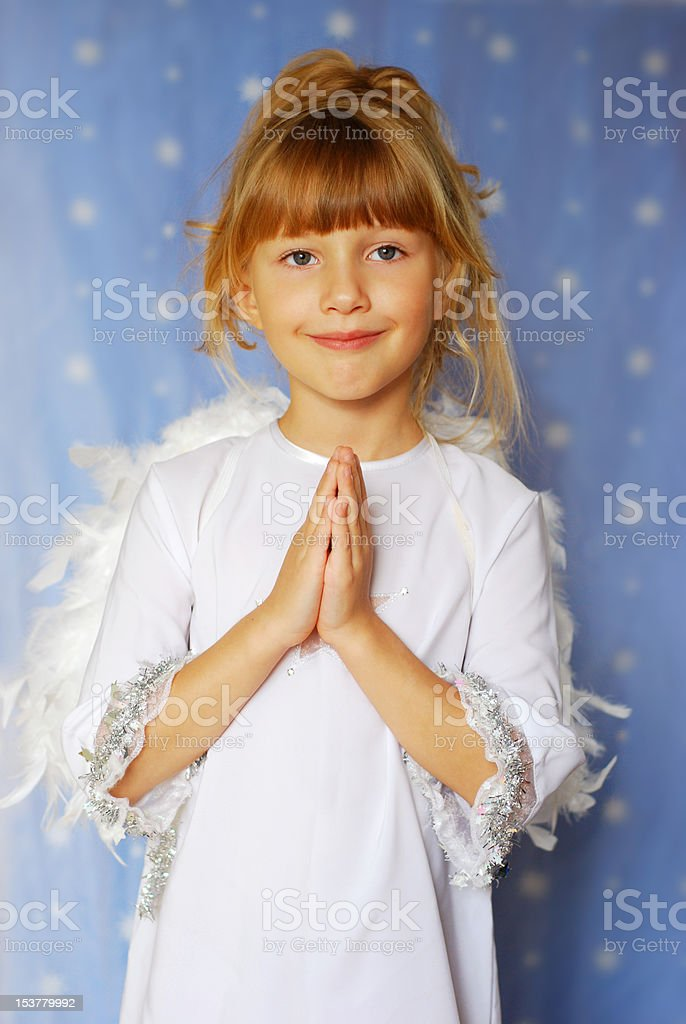 angel girl with hands  folded  to the prayer royalty-free stock photo