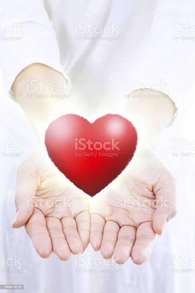 Angel giving heart royalty-free stock photo