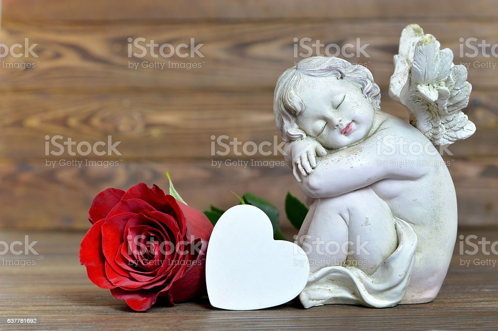Angel, heart and red rose stock photo