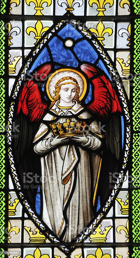 Angel holding crown stock photo
