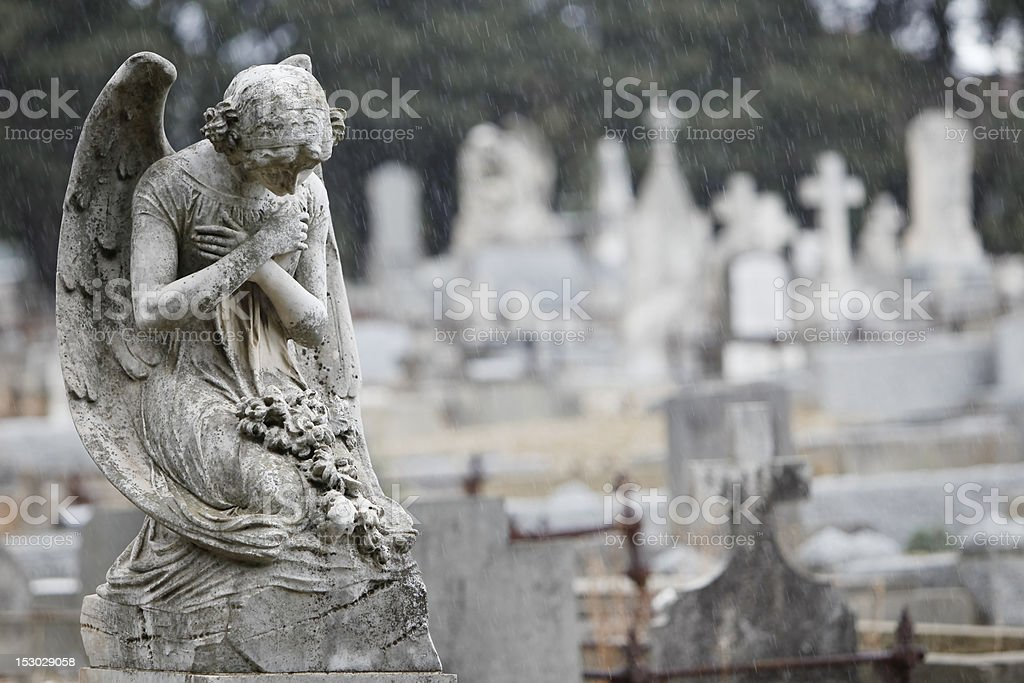 Angel in prayer stock photo