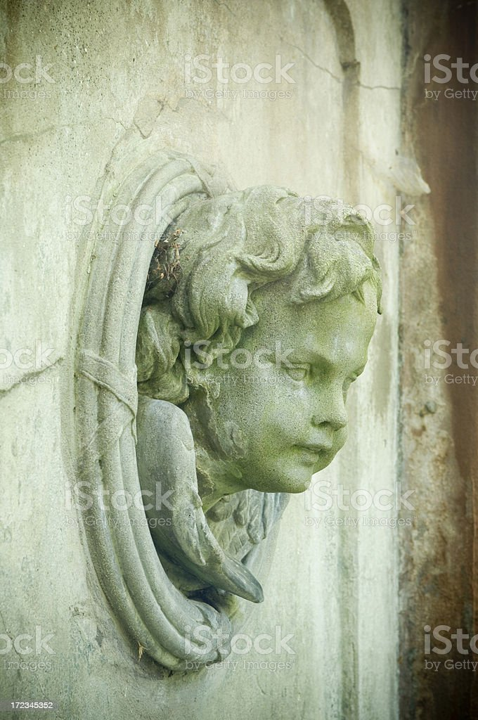 Angel in wall stock photo