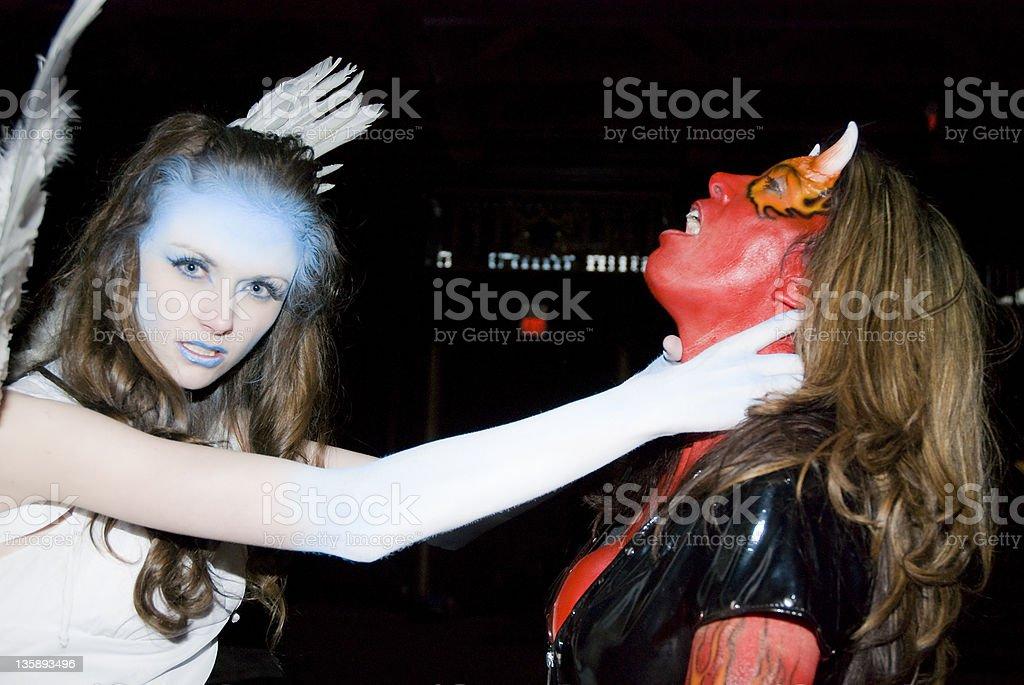Angel Killing a Devil stock photo