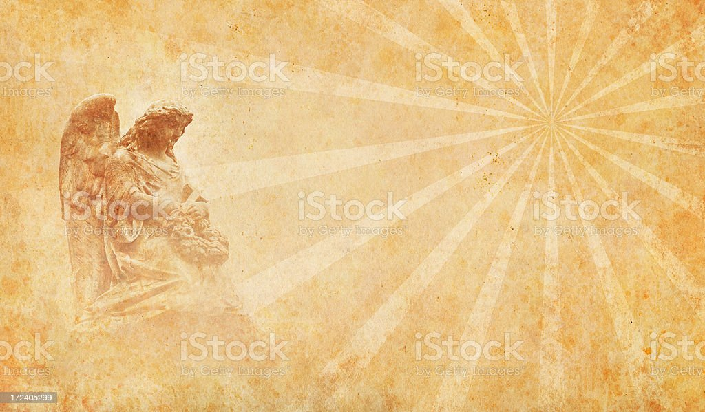 angel on old paper with rays stock photo