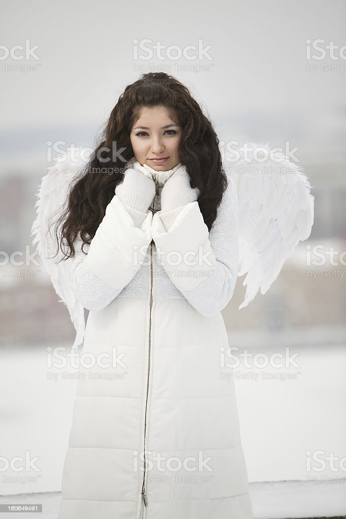 Angel on the roof looking at camera royalty-free stock photo