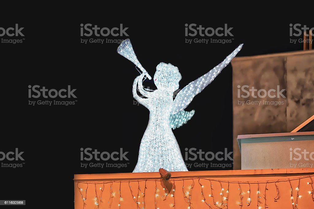 Angel on the roof of building in Riga stock photo