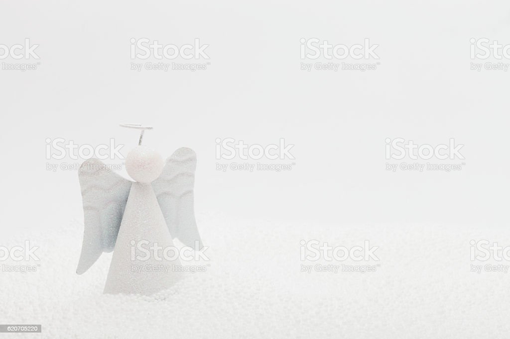 Angel ornament in fake snow stock photo