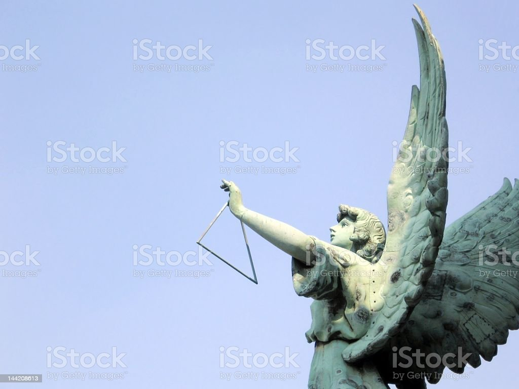 Angel playing triangle royalty-free stock photo
