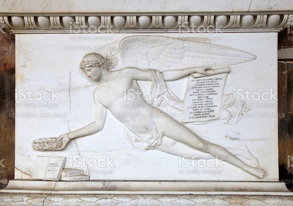 Angel relief on marble tomb in a graveyard, Italy stock photo