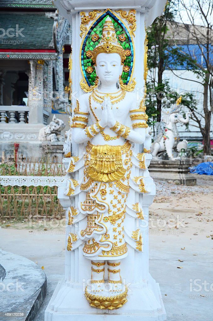 Angel sculpture on the facade of Wat Ming Mueang stock photo