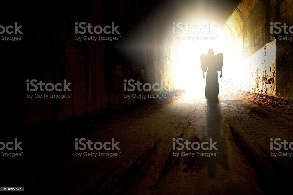 Angel Silhouette At End Of Tunnel stock photo
