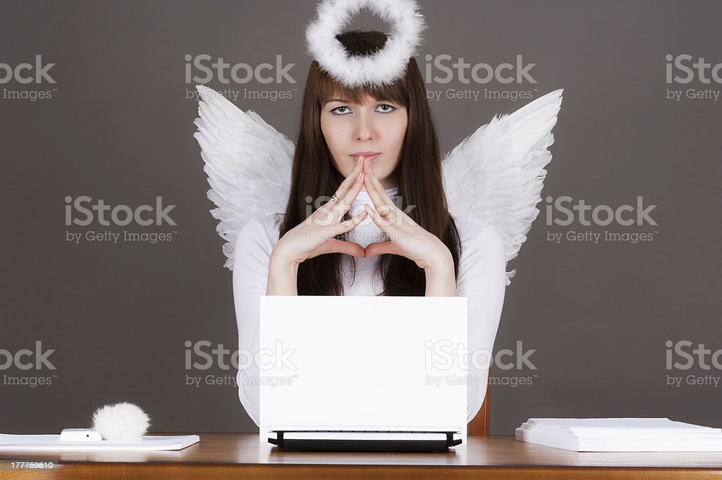 angel sitting at the computer royalty-free stock photo