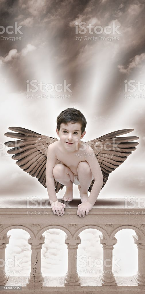 Angel sitting on balustrade stock photo
