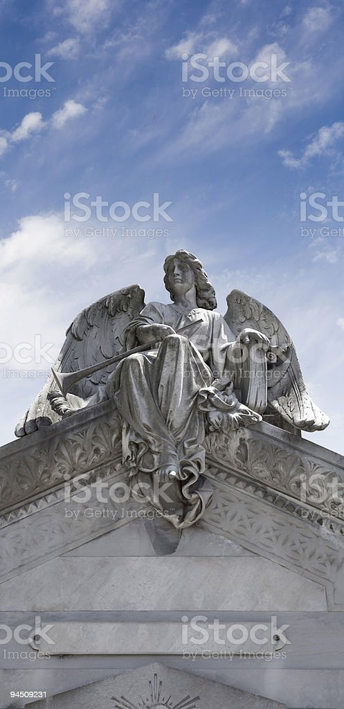 Angel sitting on the roof Buenos Aires cementary Recoleta stock photo