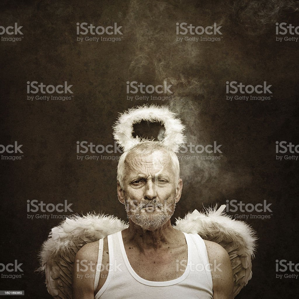 angel smoking cigarette stock photo
