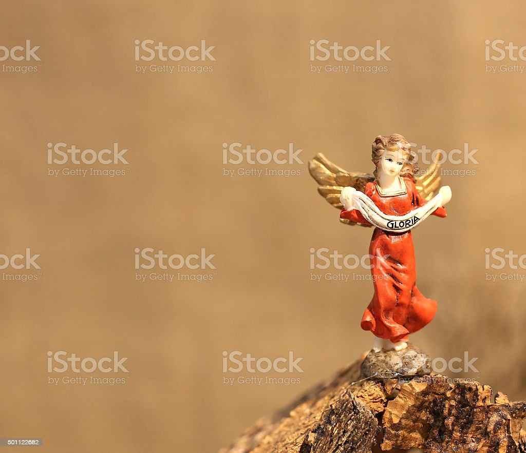 angel statue and the written GLORIA symbol of peace stock photo