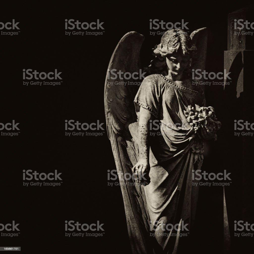 angel statue at the cemetery stock photo