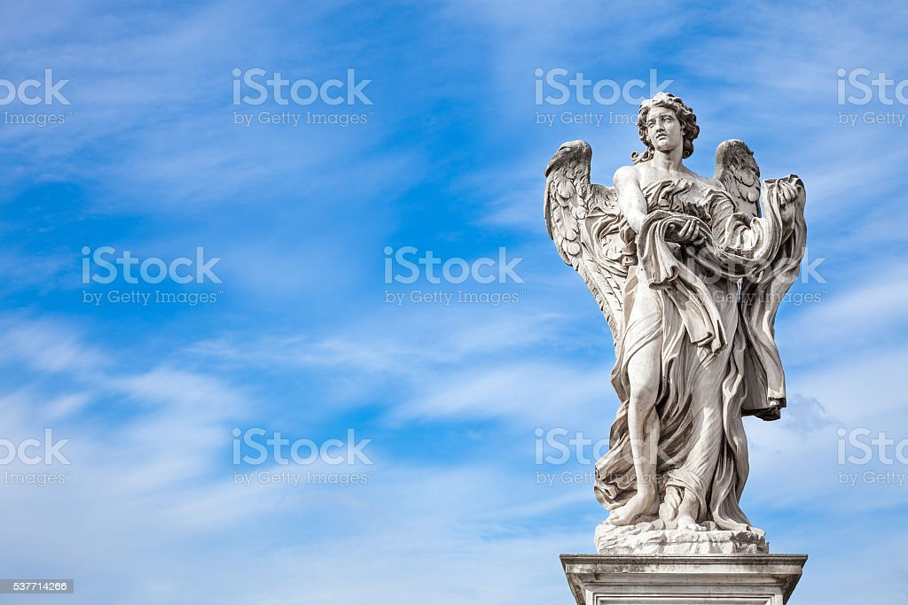 Angel statue by Bernini along Sant'Angelo bridge in Rome stock photo