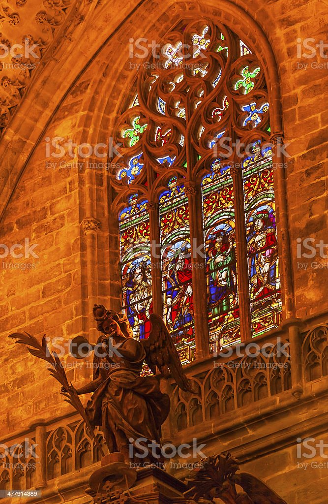 Angel Statue Stained Glass Seville Cathedral Spain royalty-free stock photo