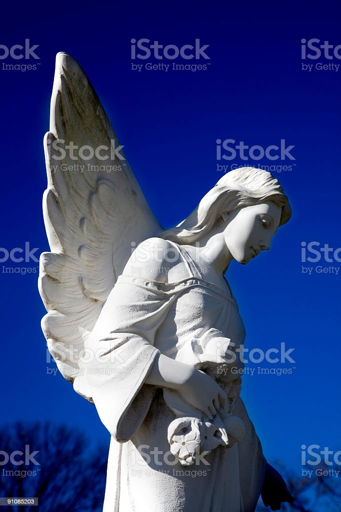 Angel surrounded by blue royalty-free stock photo