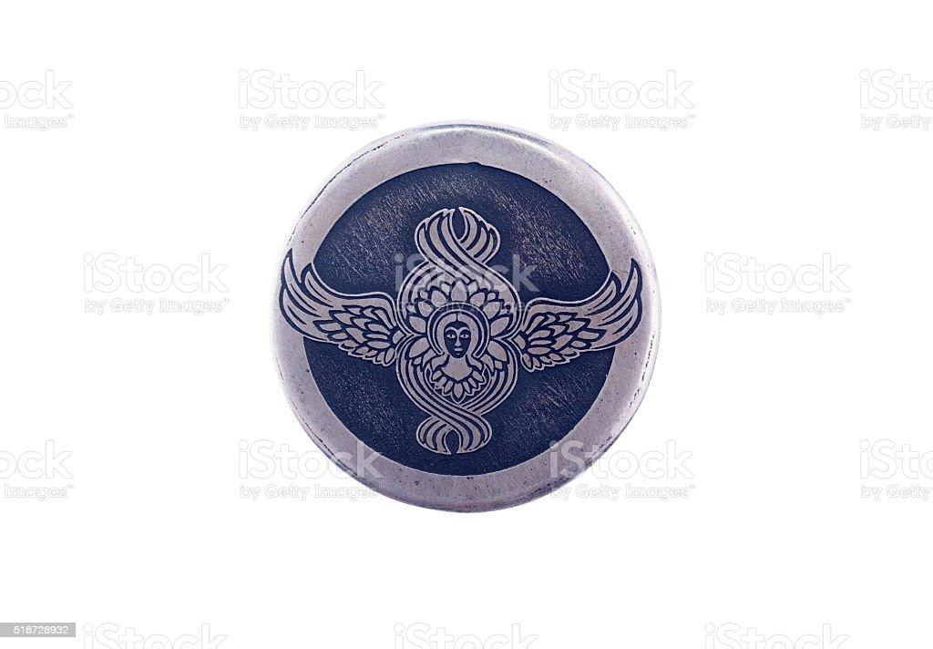 angel symbol on a silver pendant stock photo