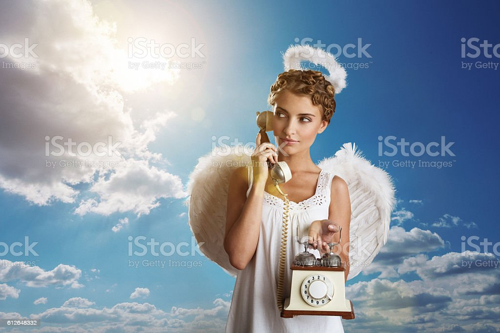 Angel using telephone stock photo