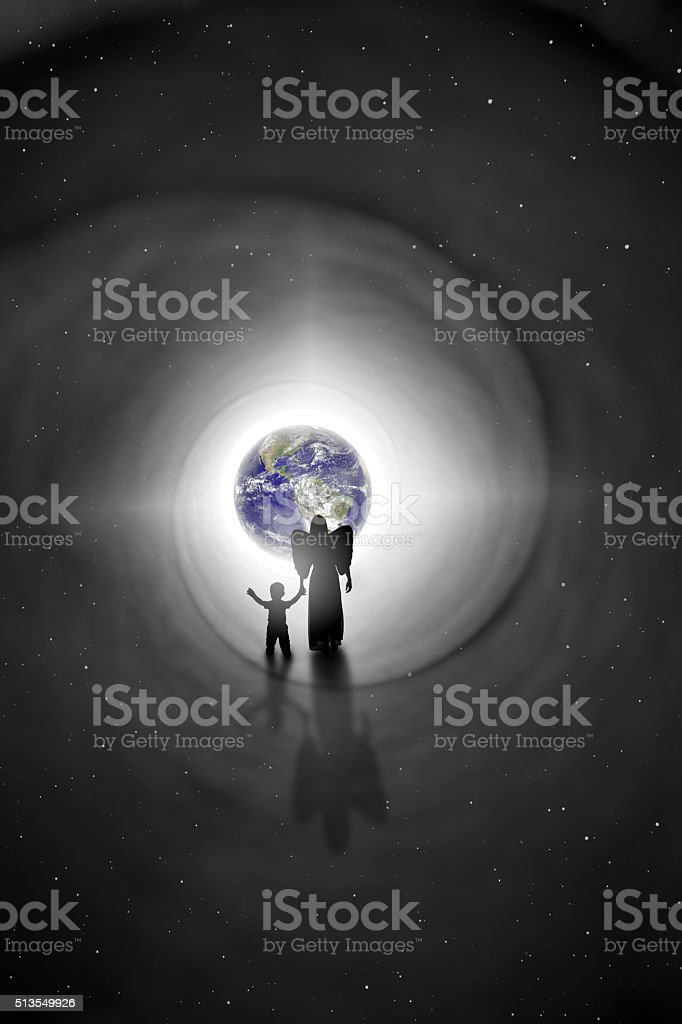 Angel Walking Child Back To Earth Reincarnation Concept stock photo