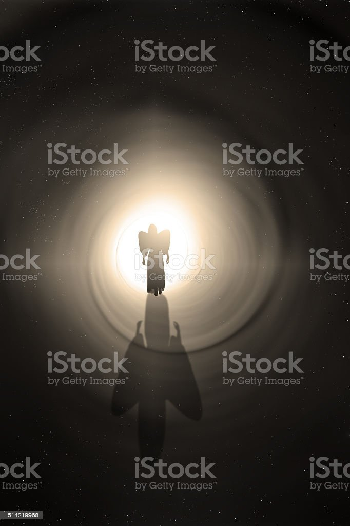 Angel Walking Toward The Light stock photo