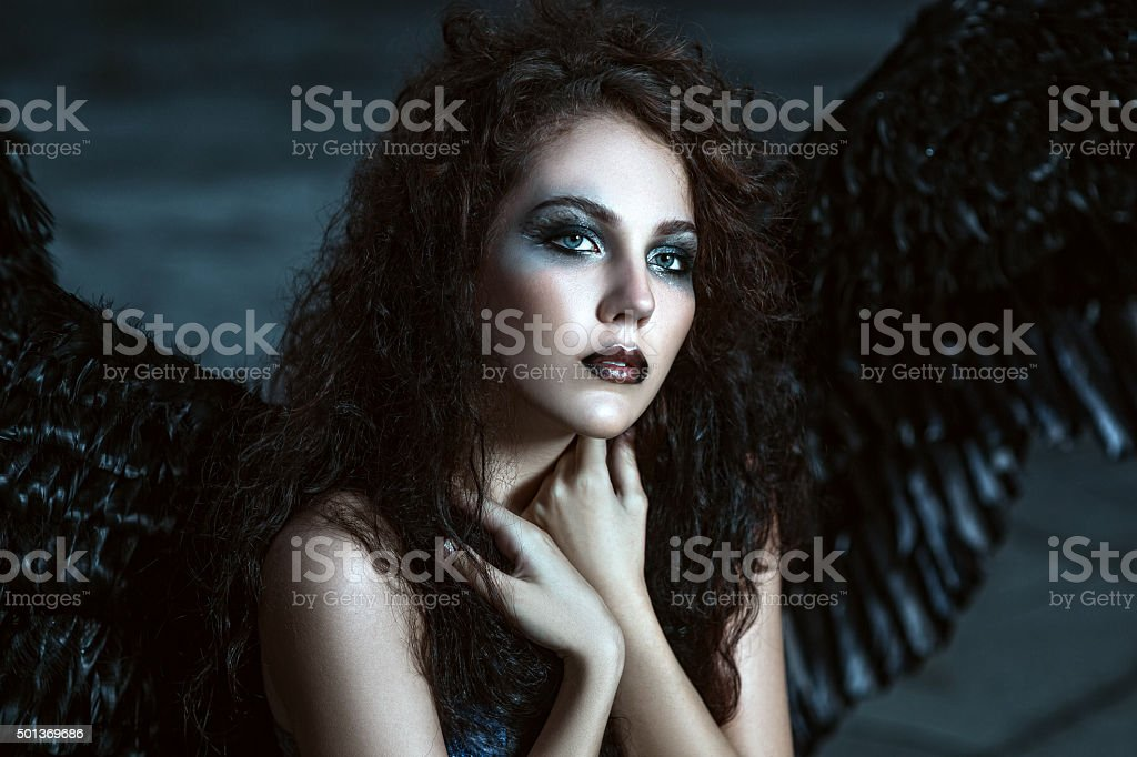 Angel with black wings stock photo