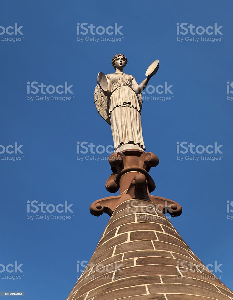 Angel with Cymbals Atop Triumphal Civil War Monument Arch stock photo