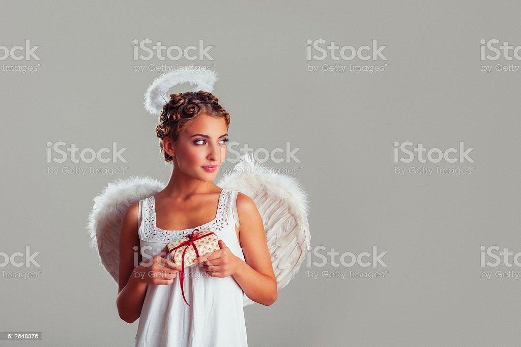 Angel with gift stock photo