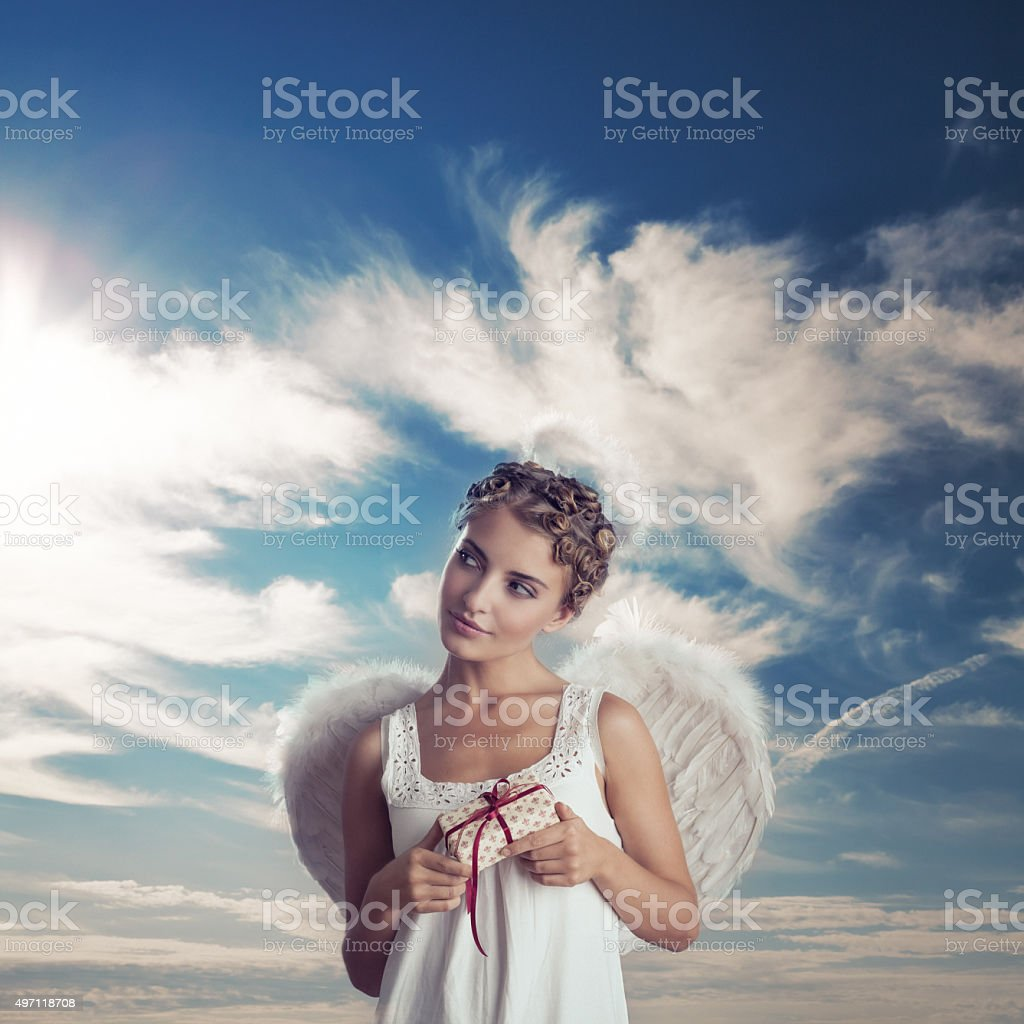 Angel with gifts stock photo