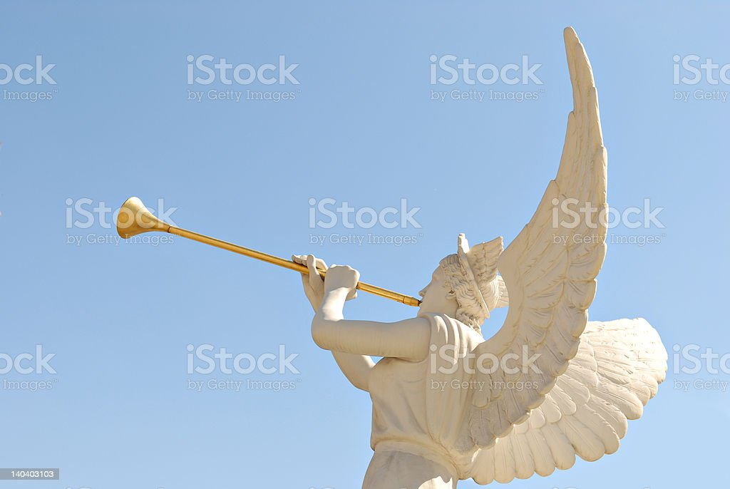 Angel with golden trumpet stock photo