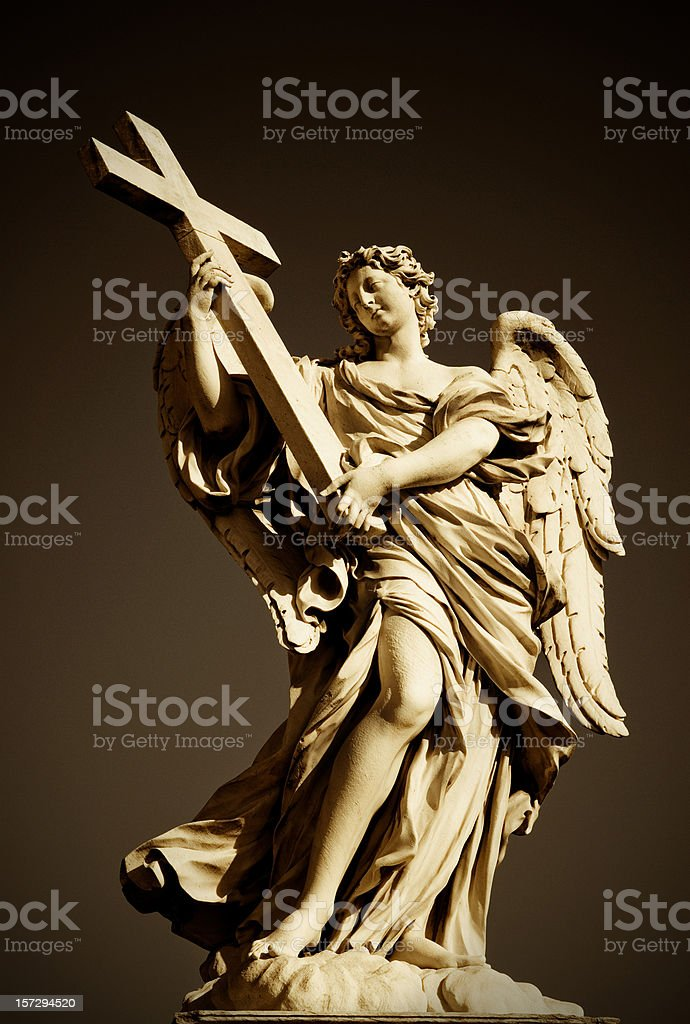 angel with the cross stock photo