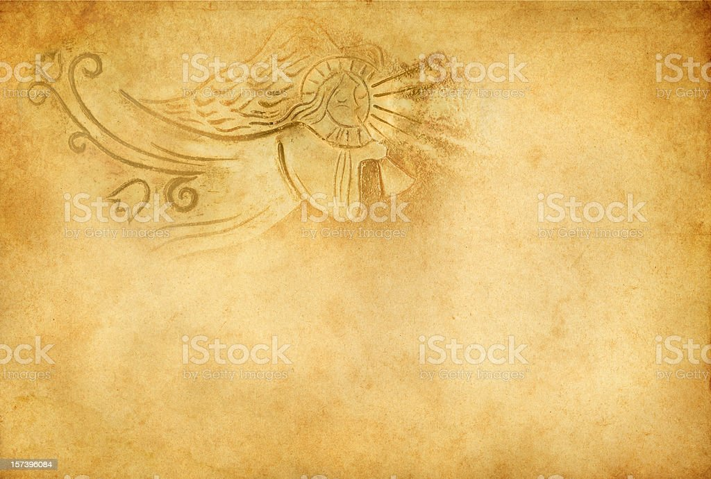 angel with trumpet on old paper stock photo