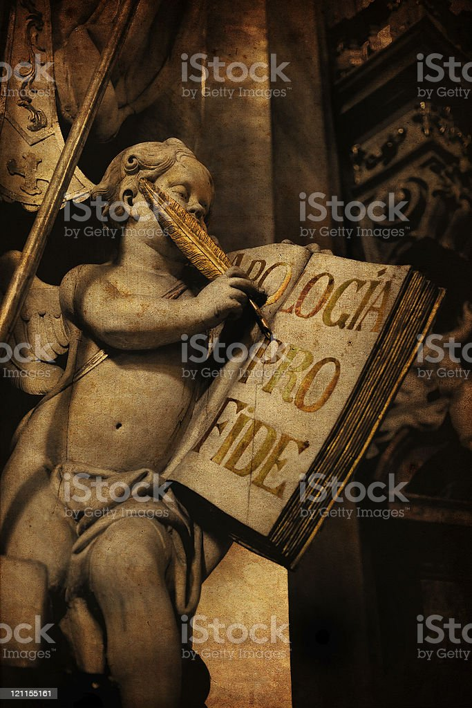 Angel writes into a huge book royalty-free stock photo