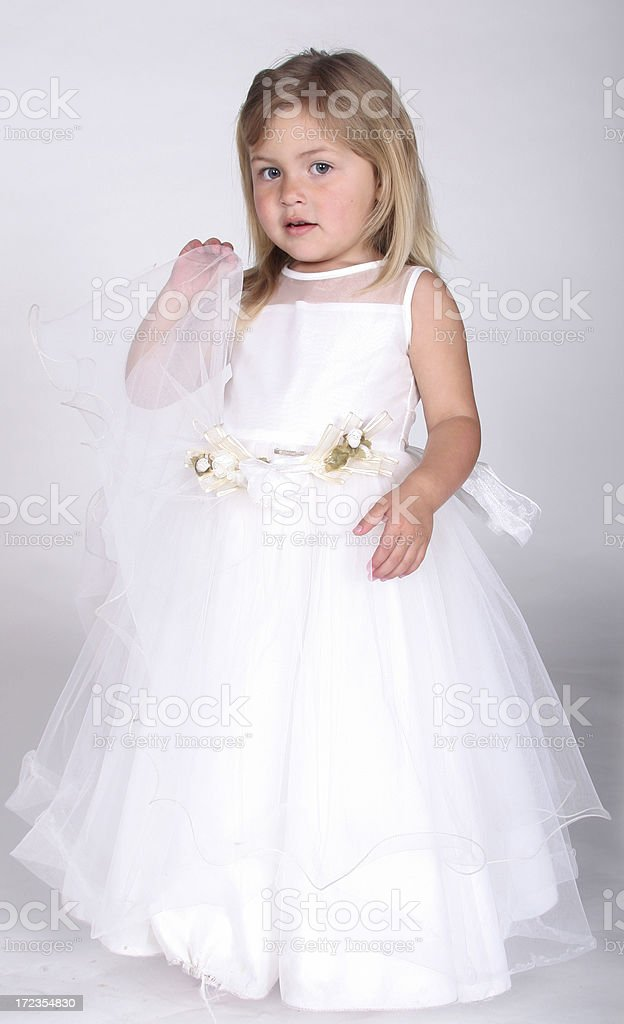 Angelic, beautiful little girl in white dress stock photo