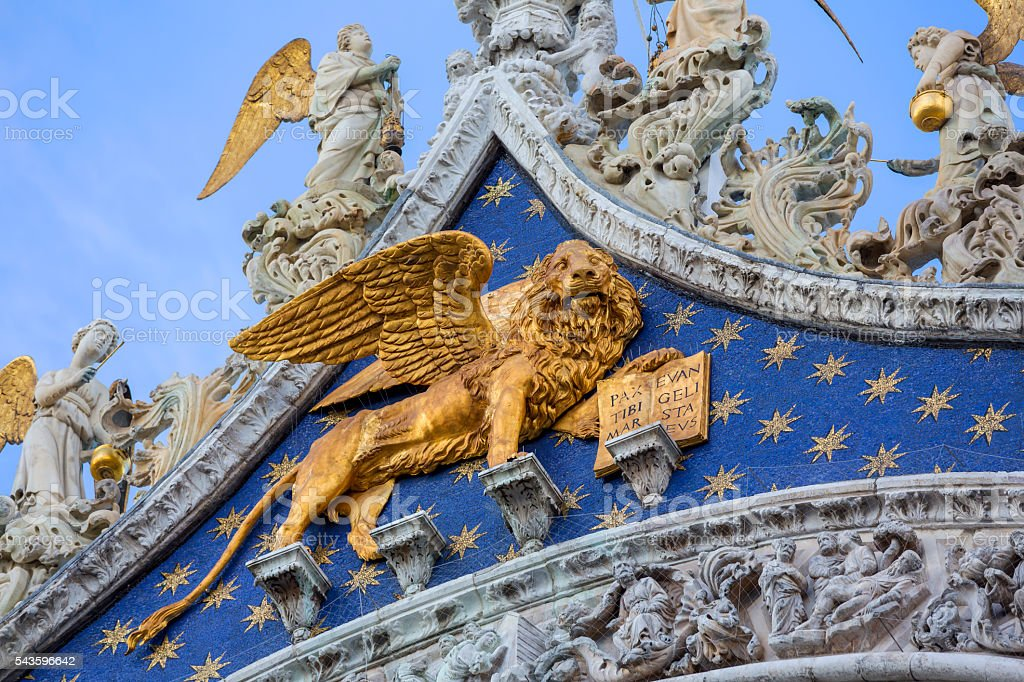 Angels and wing lion close-up St Mark's Basilica in Venice stock photo