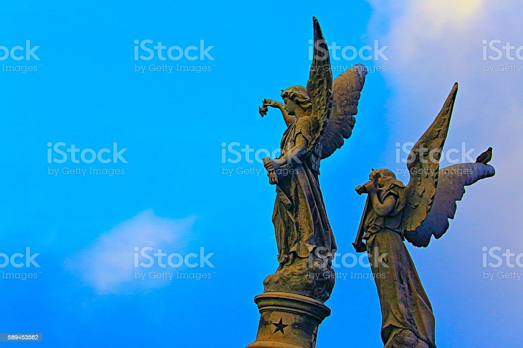 Angels looking to skies at dramatic evening, Recoleta Cemetery stock photo