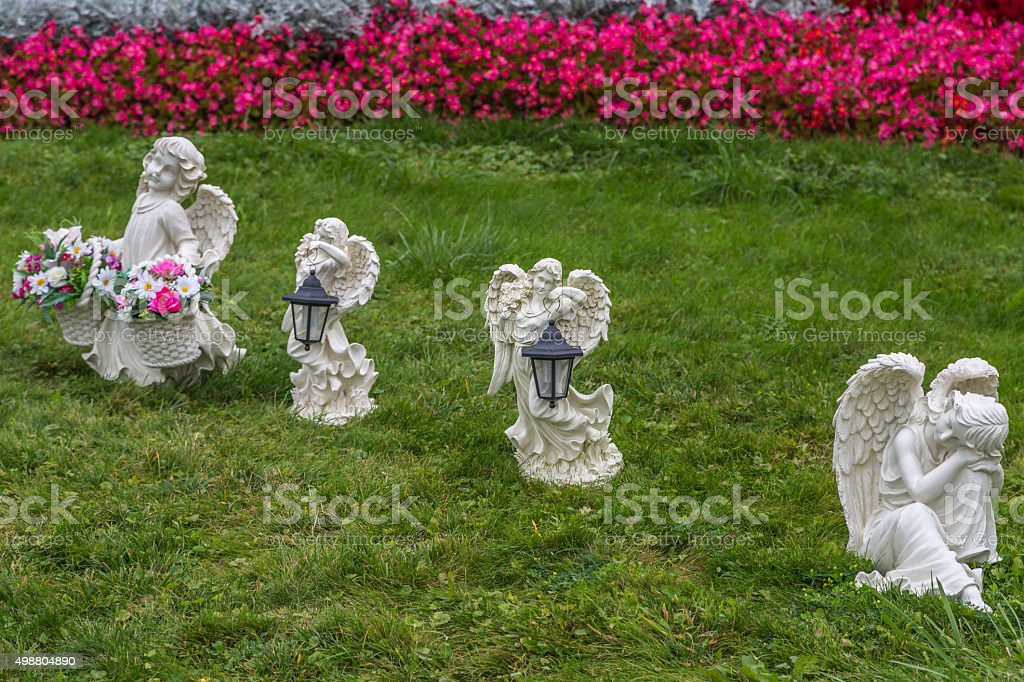 Angels on the green grass stock photo