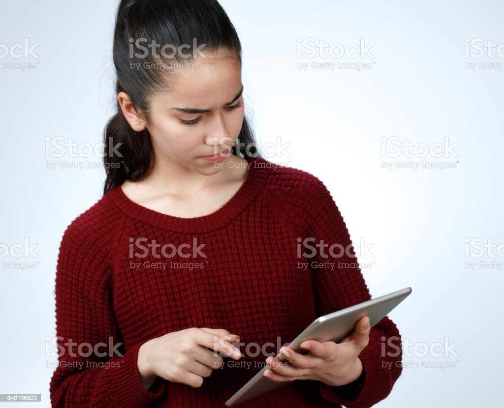 Anger Young Girl and Digital Tablet stock photo