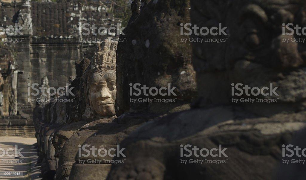 Angkor Thom, Cambodia: statue heads royalty-free stock photo
