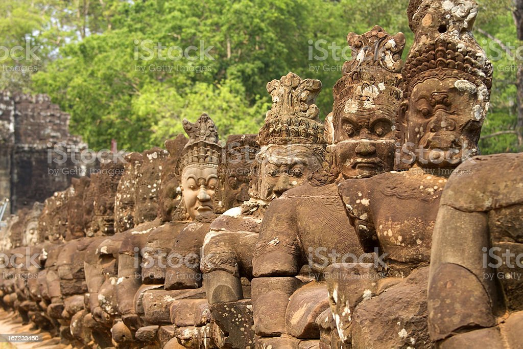 Angkor Thom, Cambodia: statues at entrance royalty-free stock photo