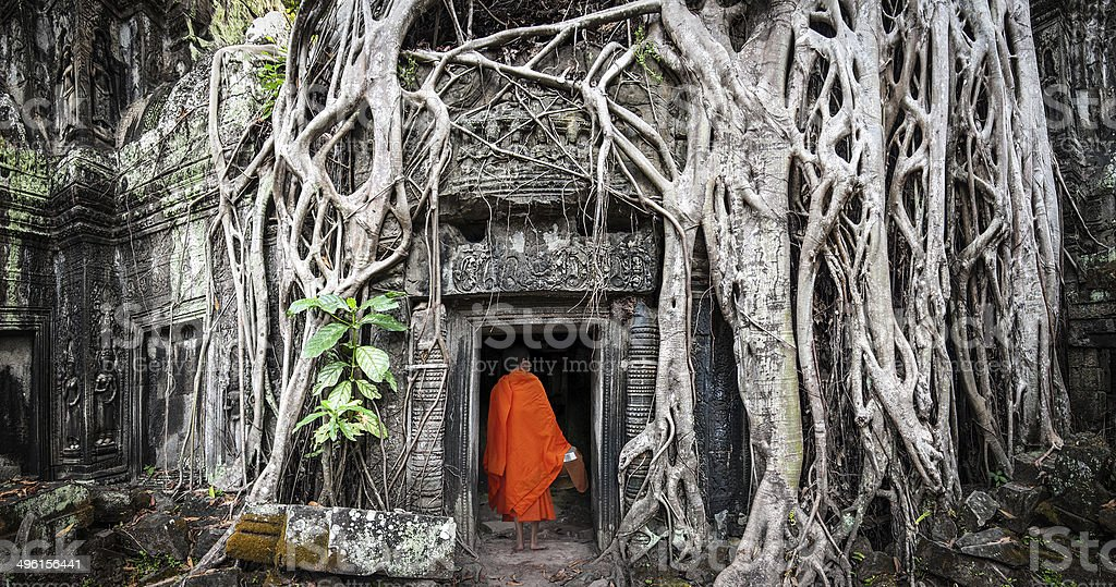 Angkor Wat monk. Ta Prom Khmer ancient Buddhist temple stock photo