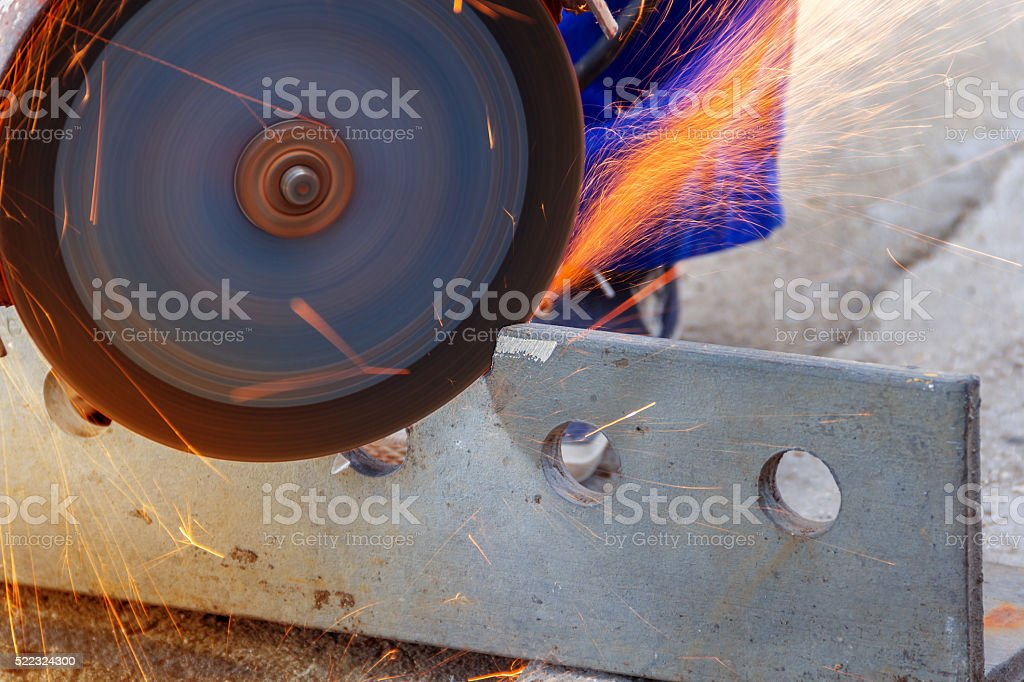 Angle grinder cutting metal stock photo